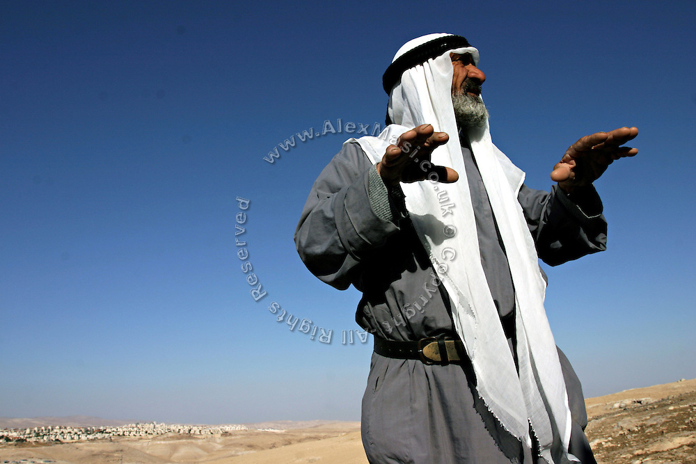 Abu Ali, a 69-years-old Bedouin man is standing near his home in the unrecognised village of Sararat, in West Bank zone C (Israeli controlled), close to Jerusalem, the capital of the country. The Israeli government is forcing him to move from a land he lives in since 50 years. Part of the separation wall aimed at protecting the large Jewish settlements in the area has been planned to pass trough his propriety. Numbering around 200.000 in Israel, the Bedouins constitute the native ethnic group of these areas, they farm, grow wheat, olives and live in complete self sufficiency. Many of them were in these lands long before the Israeli State was created and their traditional semi-nomadic lifestyle is now threatened by Governmental policies.