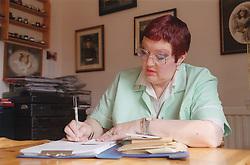 Carer filling out time sheet,