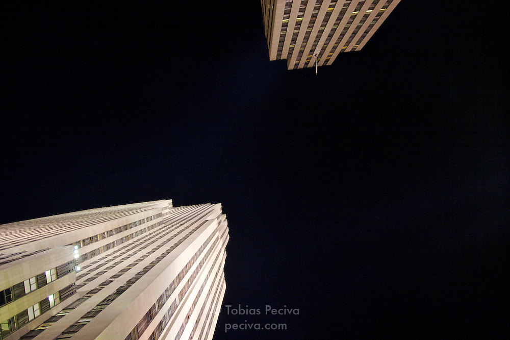 Nighttime view of the Rockefeller Center, with the GE Building at 30 Rockefeller Plaza on the left. Manhattan, New York.