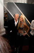Giorgio Armani and Donatella Versace, Giorgio Armani, ' A retrospective' sponsored by Mercedes, Royal Academy, 14 October 2003. © Copyright Photograph by Dafydd Jones 66 Stockwell Park Rd. London SW9 0DA Tel 020 7733 0108 www.dafjones.com
