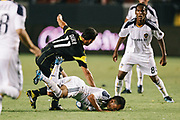 Los Angeles Galaxy midfielder Juninho, falls as he battles Columbus Crew midfielder Dilly Duka for the ball during the second half of an MLS soccer match Saturday, Sept. 11, 2010, in Carson, Calif. The Galaxy won 3-1. (AP Photo/ Bret Hartman)