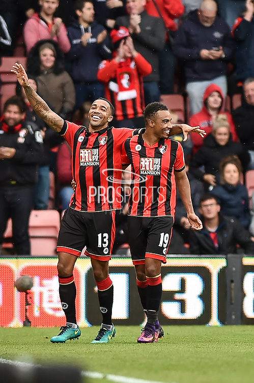 AFC Bournemouth Forward, Callum Wilson (13) and AFC Bournemouth Midfielder, Junior Stanislas (19) celebrates 5-1 during the Premier League match between Bournemouth and Hull City at the Vitality Stadium, Bournemouth, England on 15 October 2016. Photo by Adam Rivers.