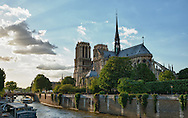 A high dynamic range photo of the sun setting behind Notre Dame Cathedral in Paris, France on May 16, 2012.