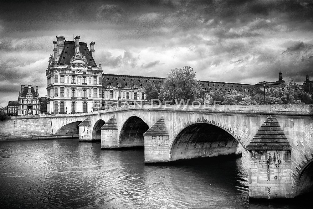 Even an overcast day doesn't diminish the incredible architecture of Paris. The design of the bridge (Pont Royal) and the ornate structure of the Louvre Museum in the background are stunning.