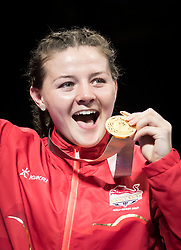England's Sandy Ryan celebrates her winning gold during the Woman's Welter (64-69kg) final at Oxenford Studios during day ten of the 2018 Commonwealth Games in the Gold Coast, Australia.