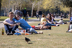 © Licensed to London News Pictures. 23/04/2021. London, UK. Members of the public relax and enjoy the sunny weather in Potters Fields Park in central London. Temperatures are expected to rise with highs of 16 degrees forecasted for parts of London and South East England today . Photo credit: George Cracknell Wright/LNP