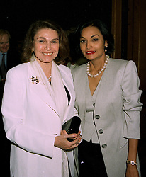 Left to right, PRINCESS EZRA JAH and MRS MICHAEL CAINE, at a party in London on 16th 1997.LZJ 30