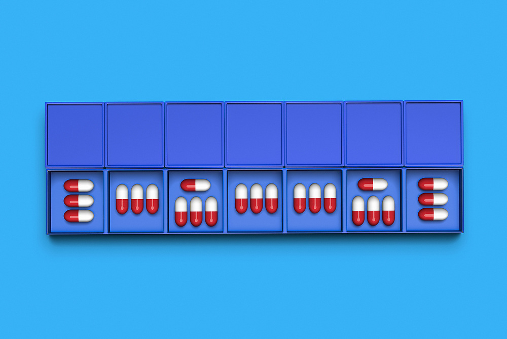 3D rendering of a pillbox for daily doses on plain background