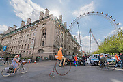 Passing the London Eye - The Tweed Run, a very British public bicycle ride through London's streets, with a prerequisite that participants are dressed in their best tweed cycling attire. Now in it's 8th year the ride follows a circular route from Clerkenwell via the Albert Memorial, Buckinham Palace and Westminster.