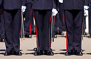 Soldiers in military dress uniform with shiny hobnail boots and swords on parade at Sandhurst Royal Military Academy, Surrey, England