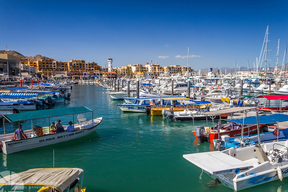 Harbor at Cabo San Lucas, Mexico, with tour boats and yachts.