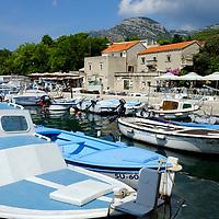 Blue empty boat in Bol Harbour; <br />Gallery Branislav Deskovic,<br />Bol, Brac, Croatia.