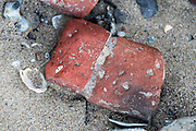 Old brickwork rubble rounded by long years in the Thames River, London, UK