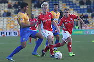 George Lapslie of Charlton Athletic (32) is halted by Malvind Benning of Mansfield Town (3), watched by Jamie Ward of Charlton Athletic (16) during the The FA Cup match between Mansfield Town and Charlton Athletic at the One Call Stadium, Mansfield, England on 11 November 2018.