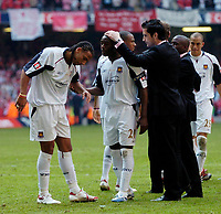 Photo: Daniel Hambury.<br />Liverpool v West Ham United. The FA Cup Final. 13/05/2006.<br />West Ham's Anton Ferdinand (L) is consoled after his penalty was saved to give the FA Cup win to Liverpool.