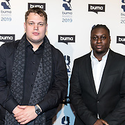 NLD/Hilversum/20190311  - Uitreiking Buma Awards 2019, Stacey Walroud (Esko) en Navarre Novian Norah (Hansie)