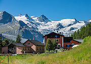"""The icy Bernina Range rises above Ova da Roseg river valley, near Pontresina, Switzerland, in the Bernina Alps, Roseg Glacier flows from Piz Glüschaint (3594 m). Val Roseg is in the Swiss canton of Graubünden (or Grisons / Grigioni / Grischun); the lower Roseg Valley is in Pontresina, whereas the upper valley is in an exclave of Samedan Municipality. Hike from Pontresina up Roseg Valley to Fuorcla Surlej for stunning views of Piz Bernina and Piz Roseg, finishing at Corvatsch Mittelstation Murtel cable car. Walking 14 km, we went up 1100 meters and down 150 m. Optionally shorten the hike to an easy 4 km via round trip lift. The Swiss valley of Engadine translates as the """"garden of the En (or Inn) River"""" (Engadin in German, Engiadina in Romansh, Engadina in Italian), and is part of the Danube basin."""