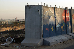 Blast walls are painted with children's pictures inside the Gush Katif settlements, Gaza, Palestinian Territories, Nov. 6, 2004. Israel's parliament recently supported compensation payments for Jewish settlers leaving the Gaza Strip, in a vital vote for Prime Minister Ariel Sharon's plan to evacuate the occupied territory.
