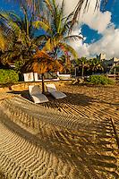 Hammock and palapas on the beach at Le Reve Hotel, Riviera Maya, Quintana Roo, Mexico