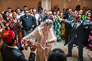 A Pamiri wedding taking place at the Marco Polo restaurant.<br /> <br /> The town of Khorog (2200m), is the capital of the Gorno-Badakhshan Autonomous Province (GBAO) in Tajikistan. It is situated in the Pamir Mountains (ancient Mount Imeon) at the confluence of the Gunt and Panj rivers.<br /> The city is bounded to the south and to the north by the deltas of the Shakhdara and Gunt rivers, respectively. The two rivers merge in the eastern part of the city flow through the city, dividing it almost evenly until its delta in the river Panj, also being known as Amu Darya, or in antiquity the Oxus on the border with Afghanistan. Khorog is known for its beautiful poplar trees that dominate the flora of the city.<br /> Khorog is one of the poorest areas of Tajikistan, with the charitable organization Aga Khan Foundation providing almost the only source of cash income. Most of its inhabitants are Ismaili Muslims.<br /> <br /> Tajikistan, a mountainous landlocked country in Central Asia. Afghanistan borders it to the south, Uzbekistan to the west, Kyrgyzstan to the north, and People's Republic of China to the east. Tajikistan also lies adjacent to Pakistan separated by the narrow Wakhan Corridor.<br /> Tajikistan became a republic of the Soviet Union in the 20th century, known as the Tajik Soviet Socialist Republic.<br /> It was the first of the Central Asian republic to gain independence in December 1991.