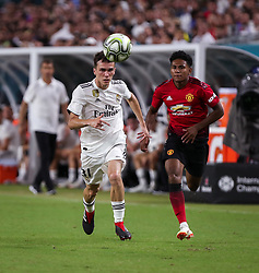 July 31, 2018 - Miami Gardens, Florida, USA - Real Madrid C.F. midfielder Federico Valverde (37) (left) chases the ball followed by Manchester United F.C. midfielder Demetri Mitchell (35) during an International Champions Cup match between Real Madrid C.F. and Manchester United F.C. at the Hard Rock Stadium in Miami Gardens, Florida. Manchester United F.C. won the game 2-1. (Credit Image: © Mario Houben via ZUMA Wire)