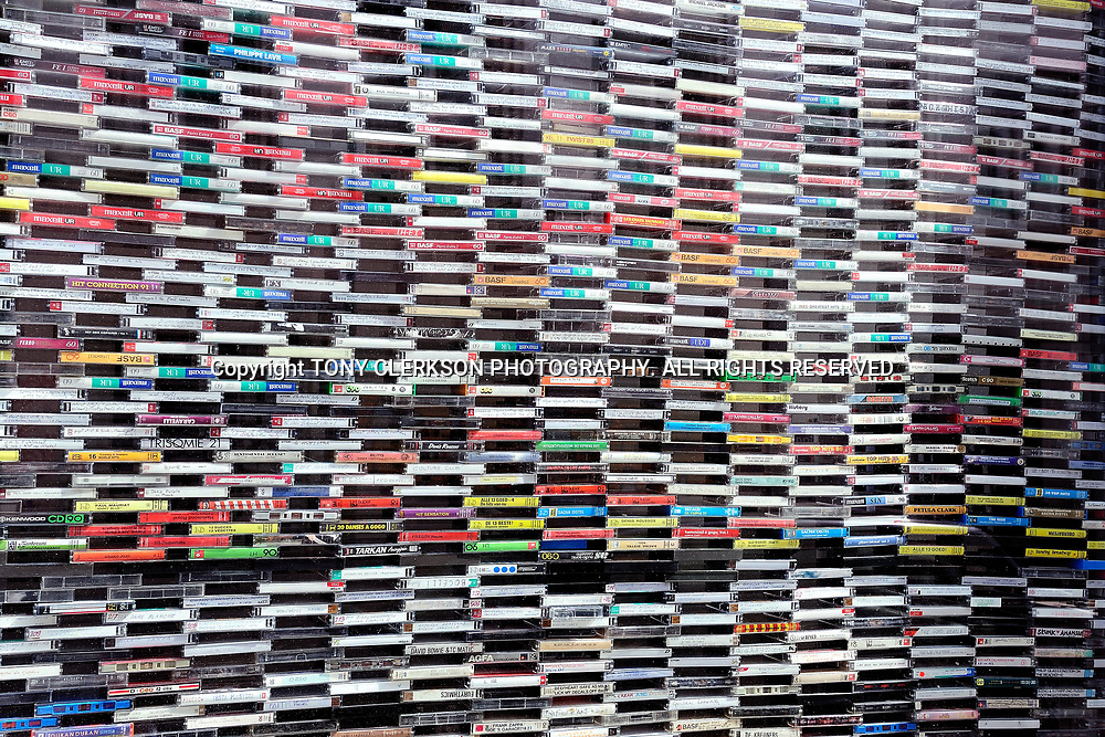 Music cassette tapes piled high to create a striking visual image