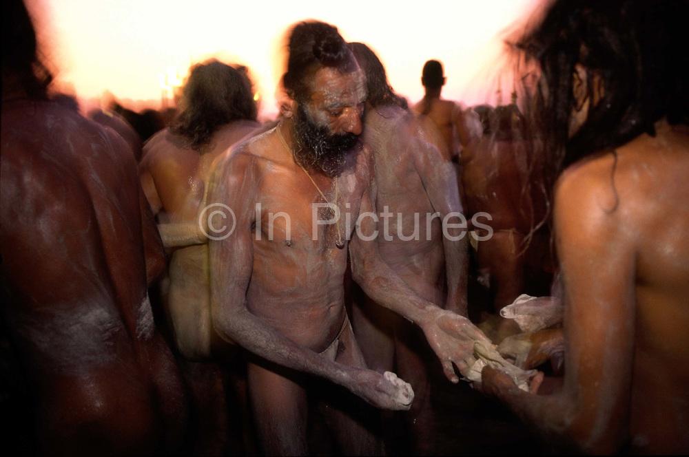 Saddhus smear themselves with ash before they bathe at the Kumbh Mela. Ardh Kumbh Mela 1995, Allahbad, India