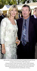 MR & MRS NICK MASON at the Chelsea Flower Show, London on 21st May 2001.	OOJ 33