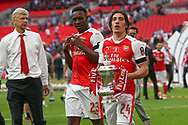 Arsenal's Héctor Bellerín(24) with the FA Cup during the The FA Cup final match between Arsenal and Chelsea at Wembley Stadium, London, England on 27 May 2017. Photo by Shane Healey.