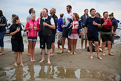 © Licensed to London News Pictures. 18/09/2016. Portsmouth, UK. Spectators watching on. Teams take part in the  Bramble Bank Cricket Match in the middle of The Solent strait on September 18, 2016. The annual cricket match between the Royal Southern Yacht Club and The Island Sailing Club, takes place on a sandbank which appears for 30 minutes at lowest tide. The game lasts until the tide returns. Photo credit: Ben Cawthra/LNP
