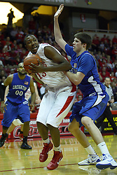 29 December 2010: John Wilkins mmakes a baseline move on Doug McDermott during an NCAA basketball game where the Creighton Bluejays defeated the Illinois State Redbirds at Redbird Arena in Normal Illinois.