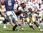 Oct 2, 2010; Charlottesville, VA, USA; Florida State Seminoles linebacker Christian Jones (7) puts pressure on Virginia Cavaliers quarterback Marc Verica (6) during the game at Scott Stadium. Florida State won 34-14.  Mandatory Credit: Andrew Shurtleff