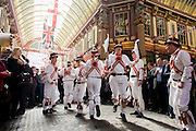 Traditional Morris Men jig in the undervover Leadenhall Market in the City of London, on England's national St George's Day the 23rd April.