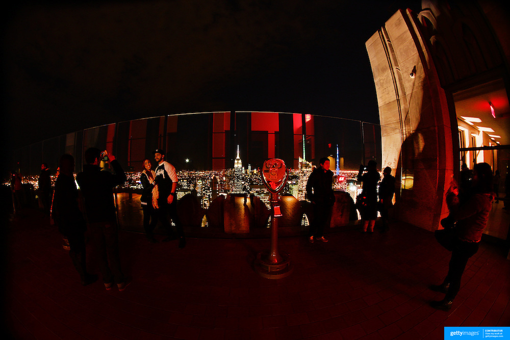 A panoramic fisheye view of Manhattan, New York, at night time as tourists visit the Top of the Rock, the observatory deck at Rockefeller Center showing the Empire State Building, Manhattan, New York, USA.  Photo Tim Clayton