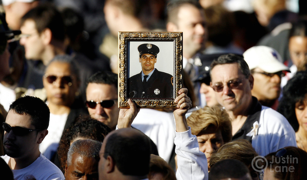 Family members listen to the names of those killed in the September 11th terrorist attacks on the World Trade Center during the September 11th commemoration ceremony in New York on Monday 11 September 2006. This year marks the five year anniversary of the attacks. ..