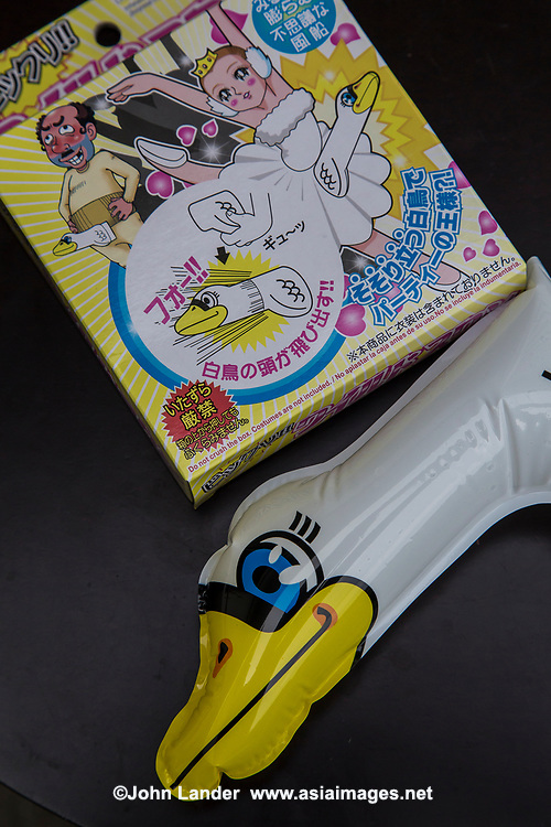 """Odd Japanese Products; Inflatable Swan Penis - Japan has long been one step ahead of the rest of the world technologically. Most people, however, don't recognize Japan for its innovations or creativity, let alone its knack for all out fantasy.   Some inventions are clever, a few are even brilliant ideas, while others are absurd but in an interesting way.  It has become such a """"thing"""" that there is even a word for it: chindogu.  Mr Kenji Kawakami, an inventor and founder of tofugu.com.  Kawakami describes the products as un-useless, which is to say almost useful but at the same time, so outlandish that people would not want to be seen using them.  He also has a few rules for chindogu:  products may not only be funny but sort of useful and products must represent freedom, never taboo and not patented.  Finally, the products must not be for sale.  Well, a few of them have slipped through the cracks.  Anything to make a buck!   Even 100 Yen shop chain Daiso now has inflatable tits.  Another gold mine for shopping for un-useless products is Don Quijote or """"donki"""" as it is known in Japan.  A few popular items: Lipstick guide stencils for klutses who can't apply makeup without smudges; karaoke mufffled microphone so you can belt out that song without anyone hearing it;  nose enhancers, and even inflatable swan-shaped penis extenders!"""