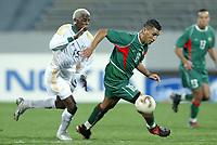 Fotball<br /> African Nations Cup 2004<br /> Afrika Mesterskapet<br /> Foto: Digitalsport<br /> Norway Only<br /> <br /> FIRST ROUND - GROUP D - 040204<br /> MOROCCO v SOUTH AFRICA<br /> MAROKKO v SØR AFRIKA<br /> <br /> YOUSSEF MOKHTARI (MOR) / SIBUSISO ZUMA (RSA)