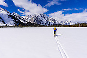 Backcountry skier under Mount Moran, Grand Teton National Park, Wyoming USA