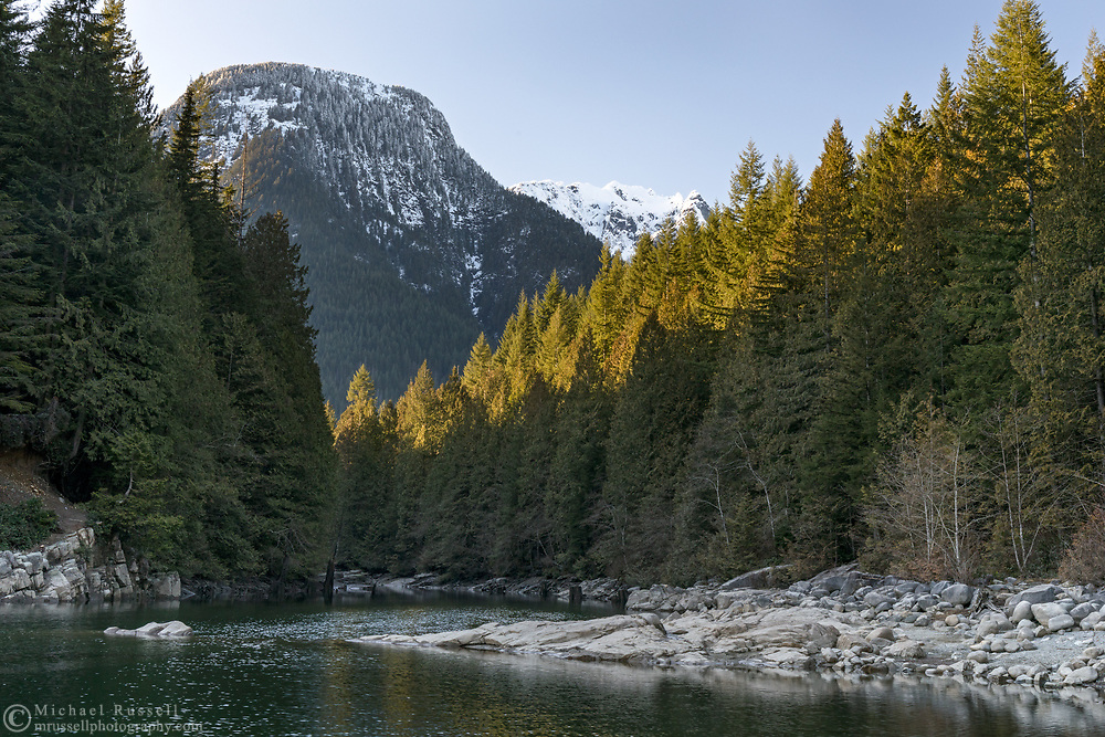 Fresh snow on Evans Peak above Gold Creek at North Beach on Alouette Lake.  Photographed at Golden Ears Provincial Park in Maple Ridge, British Columbia, Canada