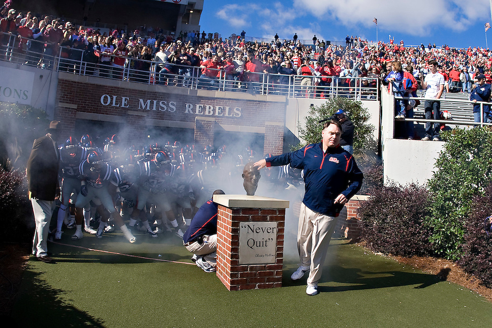 OXFORD, MS - OCTOBER 24:   Head Coach Houston Nutt of the Ole Miss Rebels leads his team onto the field before a game against the Arkansas Razorbacks at Vaught-Hemingway Stadium on October 24, 2009 in Oxford, Mississippi.  The Rebels defeated the Razorbacks 30 to 17.  (Photo by Wesley Hitt/Getty Images) *** Local Caption *** Houston Nutt