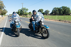 Father and son ride together - Ken McManus riding his 1936 Harley-Davidson Knucklehead (L) beside his son Matt McManus on an exactly identical machine as they lead a group of Cannonballers through some dismal weather during Stage 15 (244 miles) of the Motorcycle Cannonball Cross-Country Endurance Run, which on this day ran from Lewiston, Idaho to Yakima, WA, USA. Saturday, September 20, 2014.  Photography ©2014 Michael Lichter.