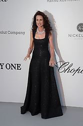 Andie MacDowell attending the 26th amfAR Gala held at Hotel du Cap-Eden-Roc during the 72nd Cannes Film Festival.