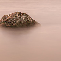 A long exposure taken at a beautiuful rocky beach in Elgol, on the southern coast of Skye.