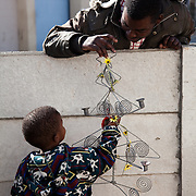 The Stars Foundation visiting Home from Home in Cape Town, South Africa...The father of this little boy comes by to visit his son who is being cared for by Daphne. They all live in the community and see each other regularly...Home from Home provide security for children who are either orphans or have been abandoned, neglected or abused . Many of the children have suffered severe abuse and more than half are HIV positive. Home from Home set up foster homes of no more than six children in local communities where there is a need and employ women to run the homes and become the registered foster mother of the children.