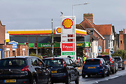 As the fuel crisis in the UK continues, this Shell petrol station is open for business as usual, motorists arrive in with their cars to fill up with fuel on the 1st of October 2021 in Folkestone, United Kingdom. Almost all the petrol stations in Folkestone have no fuel, this Shell garage took a delivery recently and now has queues over half a mile in both directions. People have been waiting for more than 2 hours to get fuel. Panic buying and long queues outside some petrol stations as the crisis, which has been caused by a lack of HGV drivers available to deliver supplies, continues.