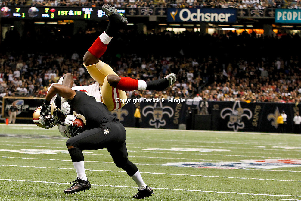 November 25, 2012; New Orleans, LA, USA; New Orleans Saints running back Darren Sproles (43) flips San Francisco 49ers outside linebacker Aldon Smith (99) over his back during the second quarter of a game at the Mercedes-Benz Superdome. Mandatory Credit: Derick E. Hingle-US PRESSWIRE