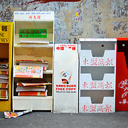 Stands of Chinese language newspapers in Chinatown, London.