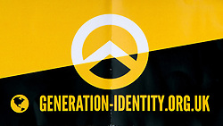 "© Licensed to London News Pictures. 11/03/2018. London, UK. Generation Identity logo from a flyer . A serial of police at the demonstration . Alt right group Generation Identity and other far-right groups hold a demonstration at Speakers' Corner in Hyde Park , opposed by antifascists . Generation Identity supporters Martin Sellner and Brittany Pettibone were due to speak at the demo but were arrested and detained by police when they arrived in the UK , also forcing them to cancel an appearance at a UKIP "" Young Independence "" youth event , which in turn was reportedly cancelled amid security concerns . Photo credit: Joel Goodman/LNP"