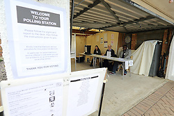 ©Licensed to London News Pictures 07/05/2015  London, UK.  Garage Polling Station, Stoats Nest Village in Coulsdon South London. Allowing a more convenient way of voting so voters don't have to go into town.  Photo credit: Presspics/LNP