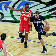 ORLANDO, FL - MARCH 03: Michael Carter-Williams #7 of the Orlando Magic drives to the net against Tony Snell #19 of the Atlanta Hawks and Danilo Gallinari #8 of the Atlanta Hawks during the first half at Amway Center on March 3, 2021 in Orlando, Florida. NOTE TO USER: User expressly acknowledges and agrees that, by downloading and or using this photograph, User is consenting to the terms and conditions of the Getty Images License Agreement. (Photo by Alex Menendez/Getty Images)*** Local Caption *** Michael Carter-Williams; Tony Snell; Danilo Gallinari